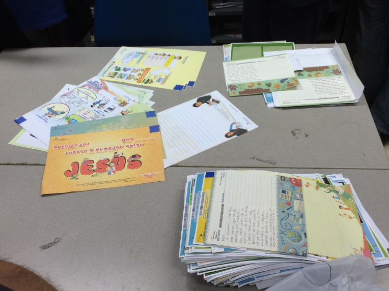 Examples of stationery the kids use and a pile of letters getting ready to go out.